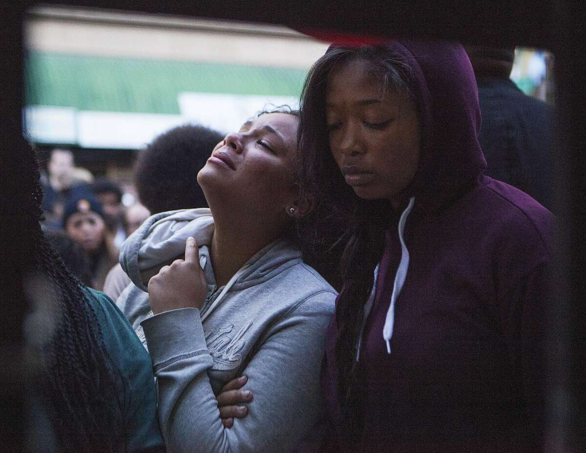 Close friends to Reggin'a Jefferies cry out during a vigil on Wednesday, June 15, 2016 in Oakland, California. Jefferies was a 16-year-old Antioch girl gunned down Tuesday in a broad-daylight shooting in downtown Oakland.