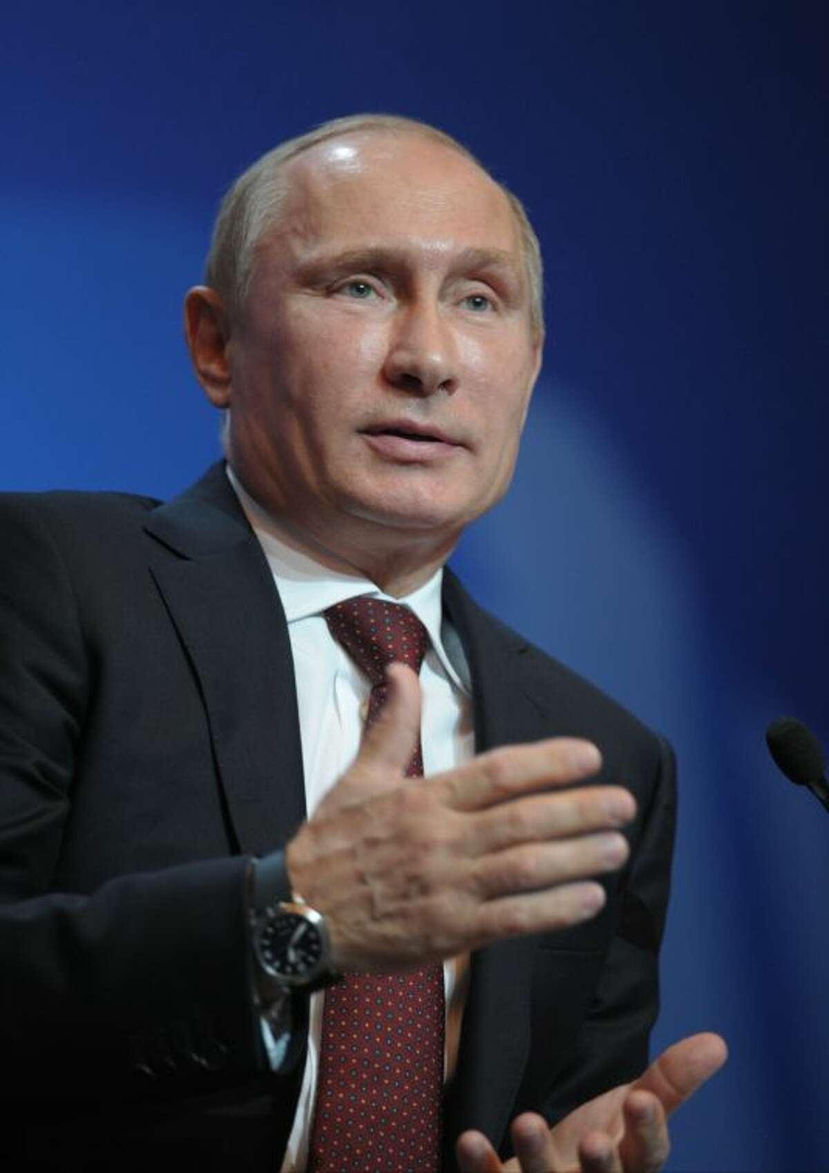 Russian President Vladimir Putin speaks at the International Arctic Forum in Salekhard, a city 1,950 km (about 1,200 miles) northeast of Moscow just above the Arctic Circle, Russia, Wednesday, Sept. 25, 2013. Putin said Wednesday that Greenpeace activists apprehended after trying to scale an offshore oil platform aren't pirates, but defended the detention saying Coast Guard officers had no way of knowing who they were.(AP Photo/RIA-Novosti, Alexei Druzhinin, Presidential Press Service)