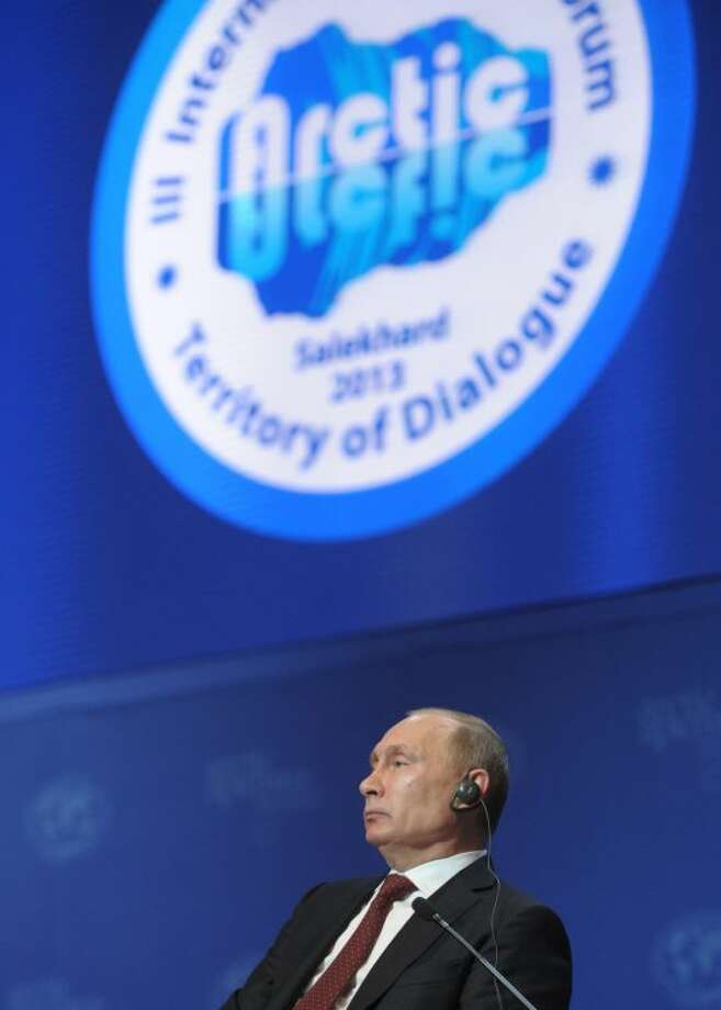 Russian President Vladimir Putin attends the International Arctic Forum in Salekhard, a city 1,950 km (about 1,200 miles) northeast of Moscow just above the Arctic Circle, Russia, Wednesday, Sept. 25, 2013. Putin said Wednesday that Greenpeace activists apprehended after trying to scale an offshore oil platform aren't pirates, but defended the detention saying Coast Guard officers had no way of knowing who they were. (AP Photo/RIA-Novosti, Alexei Druzhinin, Presidential Press Service)