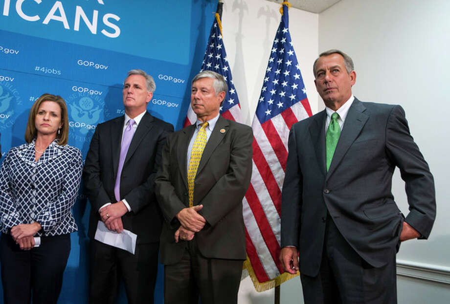 House Speaker John Boehner of Ohio, right, and House GOP leaders, participate in a news conference on Capitol Hill in Washington, Thursday, Sept. 26, 2013, as pressure builds over legislation to prevent a partial government shutdown. From left are, Rep. Lynn Jenkins, R-Kansas, House Majority Whip Kevin McCarthy of Calif., House Energy and Commerce Committee Chairman Rep. Fred Upton, R-Mich. and Boehner. (AP Photo/J. Scott Applewhite) / AP