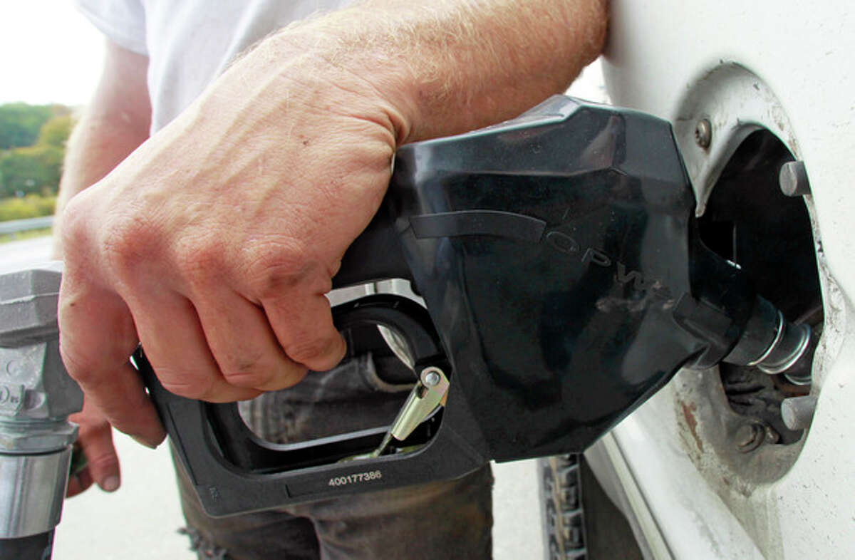 A customer fills up at a gas pump on Friday, Sept. 27, 2013 in Montpelier, Vt. The price of gas is at its lowest level since Jan. 31, it?'s the lowest it?'s been at this time of year for three years, and it is expected to fall further in the coming days. (AP Photo/Toby Talbot)