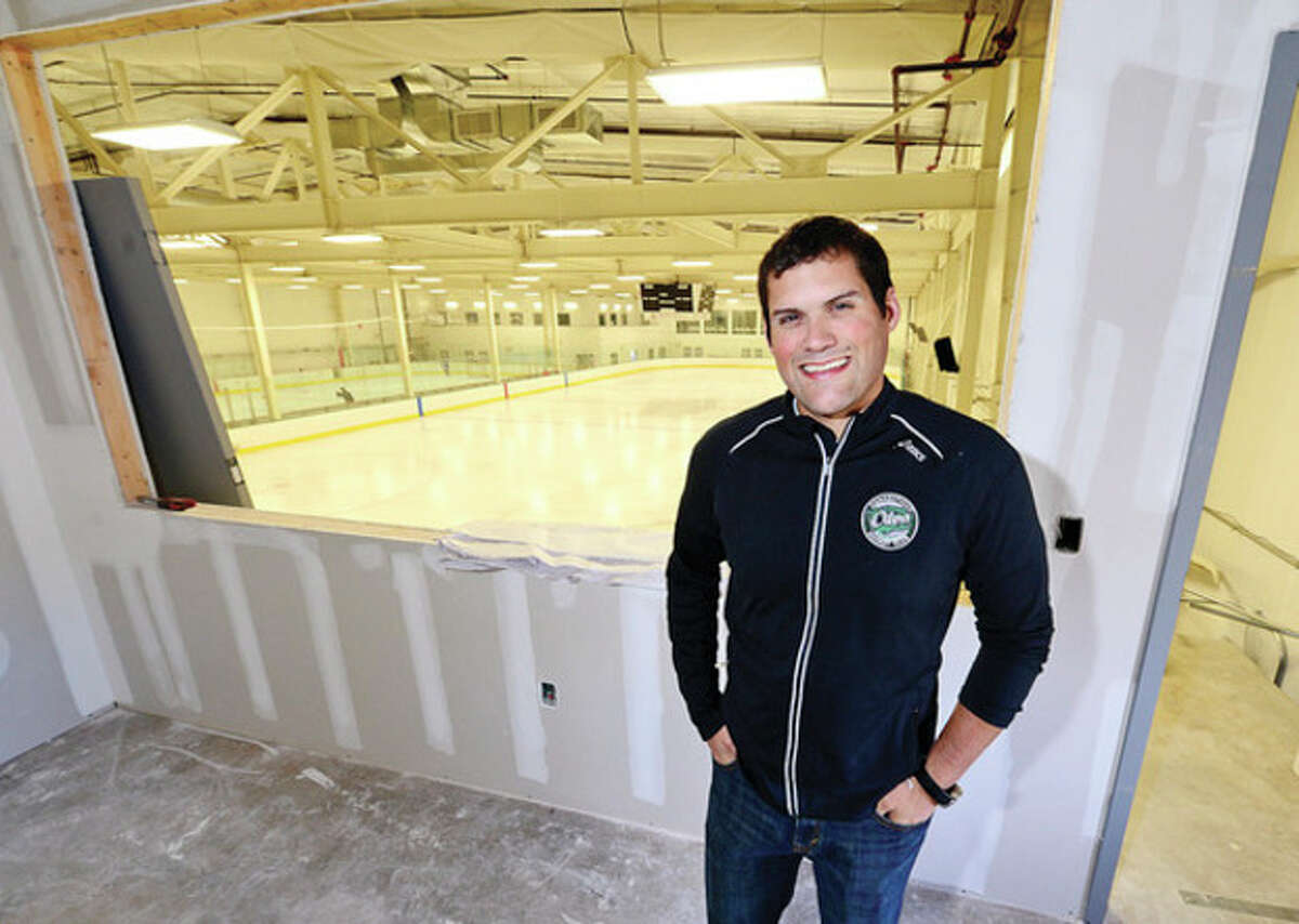 Hour photo / Erik Trautmann Ryan Hughes, president of the SoNo Ice House and Connecticut Oilers, stands in the room that will soon be his new office overlooking the ice rink.