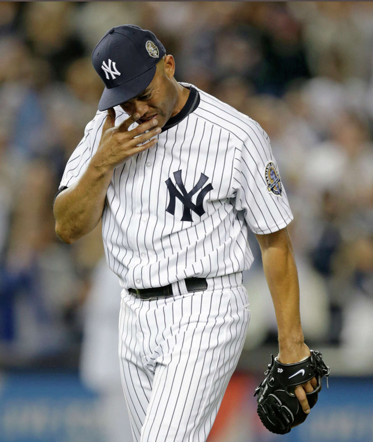 New York Yankees relief pitcher Mariano Rivera cries coming off the mound with two outs in the ninth inning of his final appearance in a baseball game at Yankee Stadium, Thursday, Sept. 26, 2013, in New York. The Yankees defeated the Tampa Bay Rays 4-0. (AP Photo/Kathy Willens)