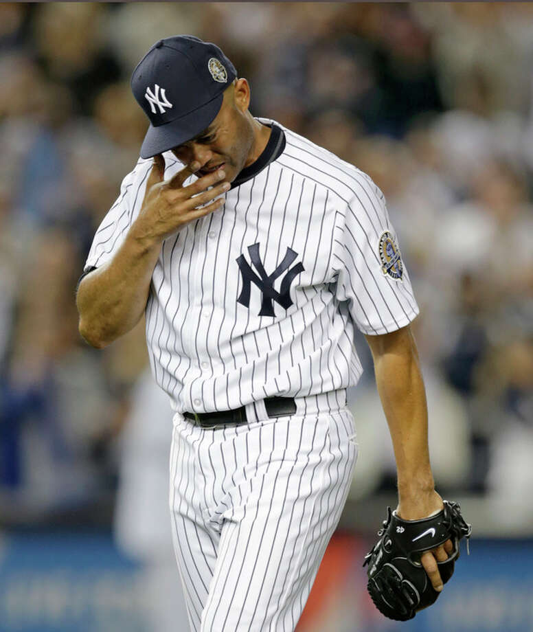 New York Yankees relief pitcher Mariano Rivera cries coming off the mound with two outs in the ninth inning of his final appearance in a baseball game at Yankee Stadium, Thursday, Sept. 26, 2013, in New York. The Yankees defeated the Tampa Bay Rays 4-0. (AP Photo/Kathy Willens) / AP