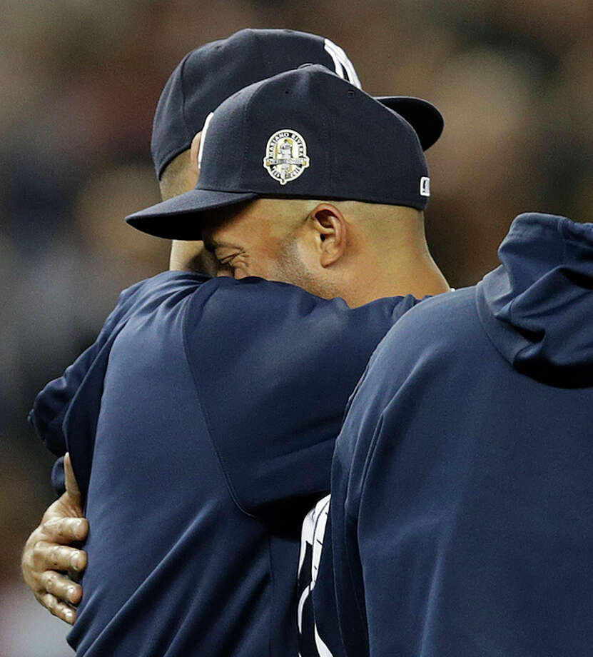 New York Yankees relief pitcher Mariano Rivera, right, embraces Yankees pitcher Andy Pettitte, who came out to the mound after Rivera's final pitching appearance in a baseball game at Yankee Stadium, against the Tampa Bay Rays on Thursday, Sept. 26, 2013, in New York. Both players are retiring after the season, which ends for the Yankees on Sunday in Houston. The Rays won 4-0. (AP Photo/Kathy Willens) / AP