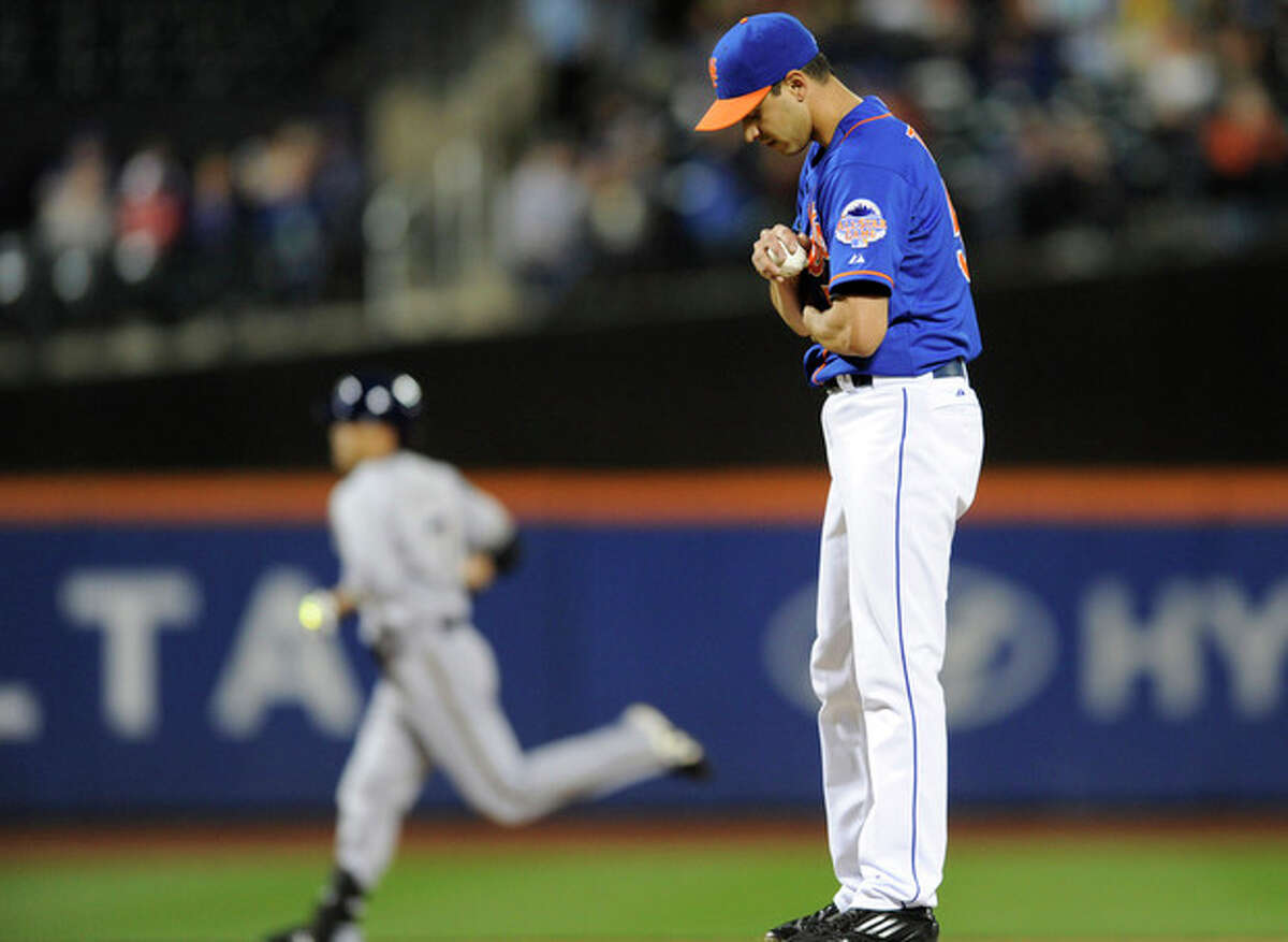 New York Mets pitcher Carlos Torres, right, reacts as Milwaukee Brewers' Norichika Aoki rounds the bases with a home run during the first inning of a baseball game Friday, Sept. 27, 2013, in New York. (AP Photo/Bill Kostroun)