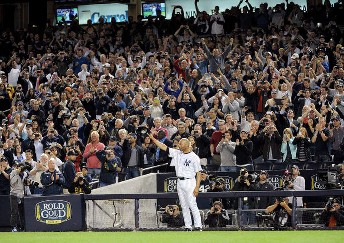 New York Yankees relief pitcher Mariano Rivera tips his cap to the fans during the ninth inning of the Yankees' baseball game against the Tampa Bay Rays on Thursday, Sept. 26, 2013, at Yankee Stadium in New York. The Yankees won 4-0 in Rivera's final home game. (AP Photo/Bill Kostroun)
