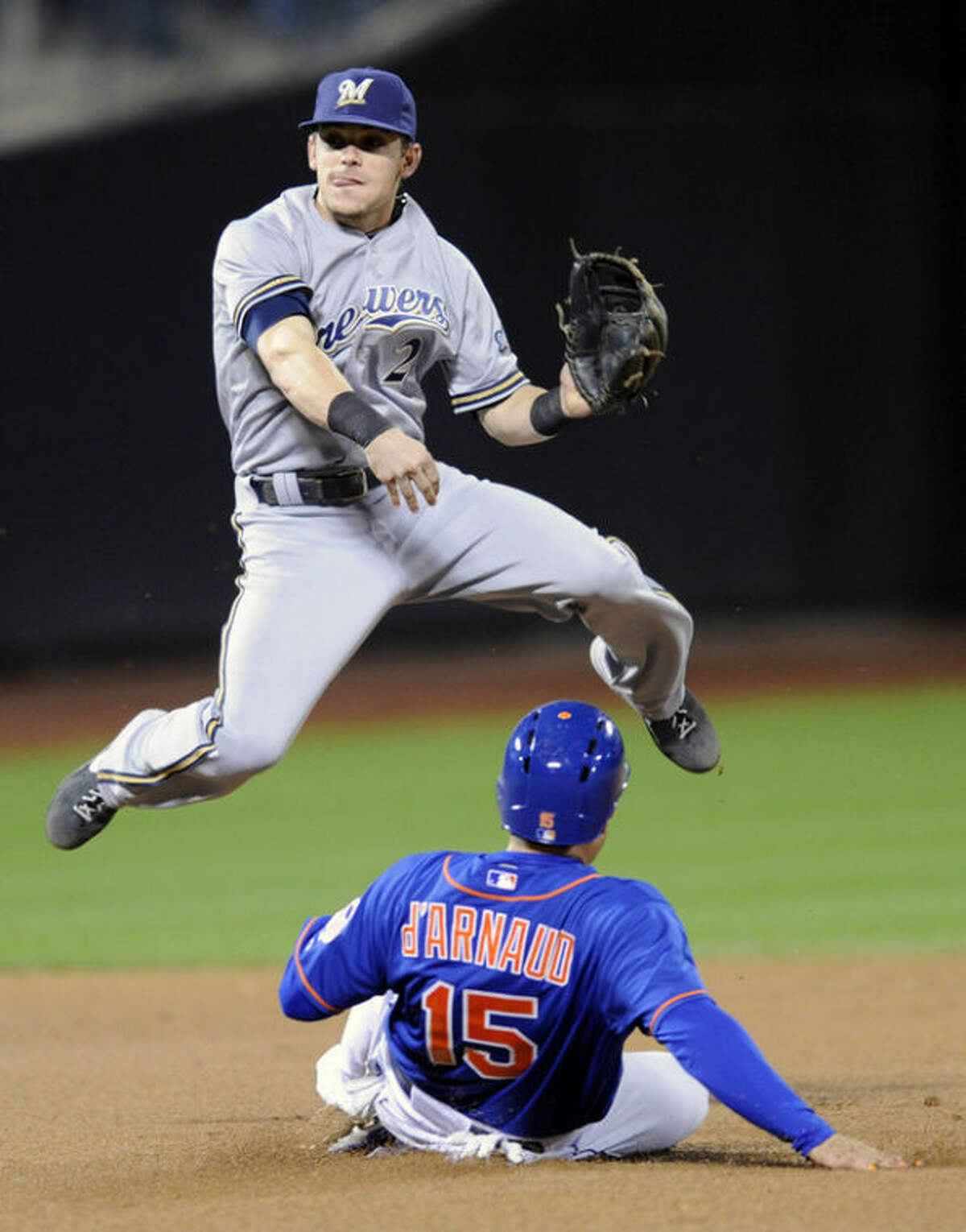 New York Mets' Travis d'Arnaud (15) is out at second base as Milwaukee Brewers second baseman Scooter Gennett relays the ball to first to complete the double play on Mets' Wilfredo Tovar during the fifth inning of a baseball game Friday, Sept. 27, 2013, in New York. (AP Photo/Bill Kostroun)