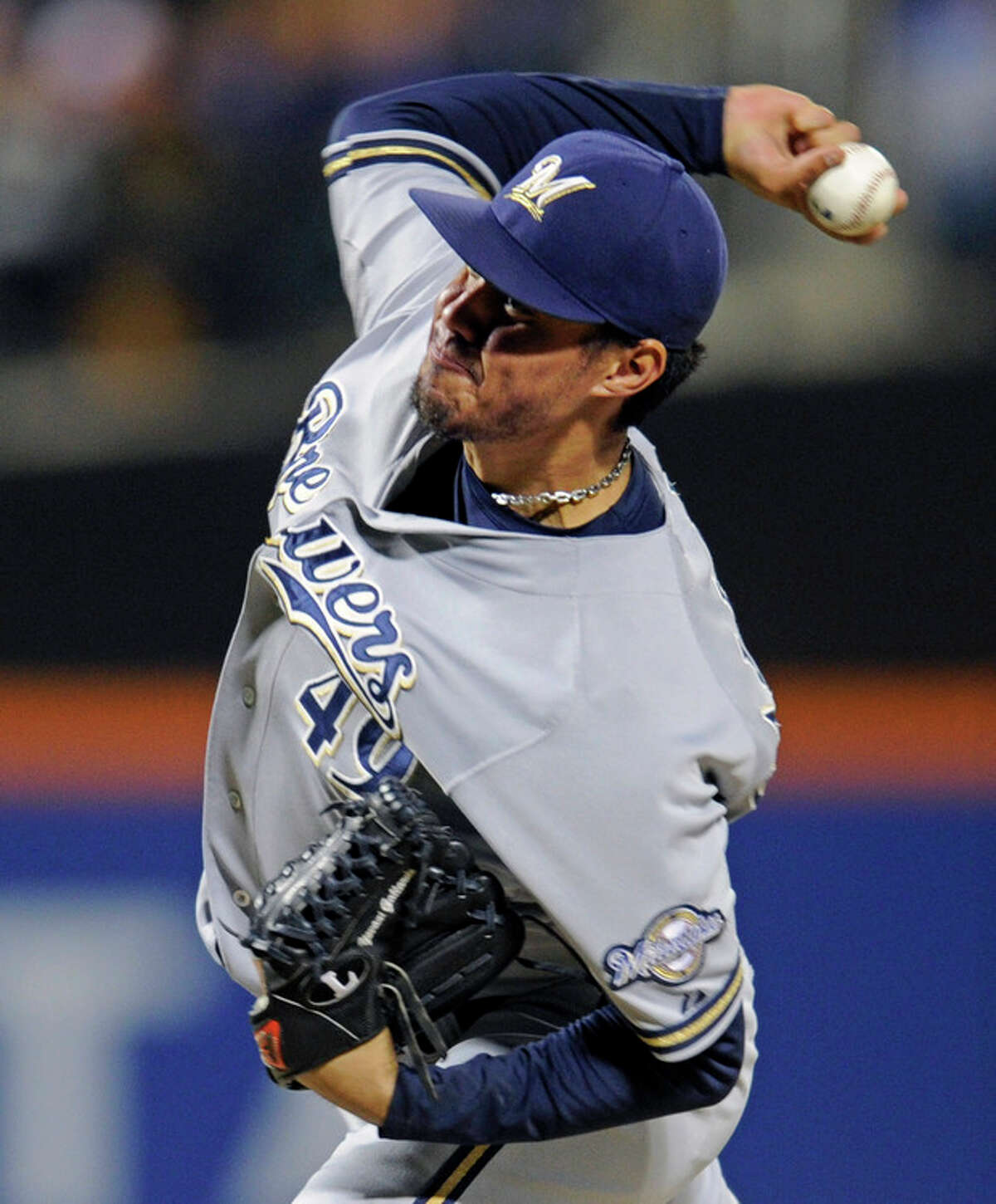 Milwaukee Brewers pitcher Yovani Gallardo delivers the ball to the New York Mets during the first inning of a baseball game Friday, Sept. 27, 2013, in New York. (AP Photo/Bill Kostroun)