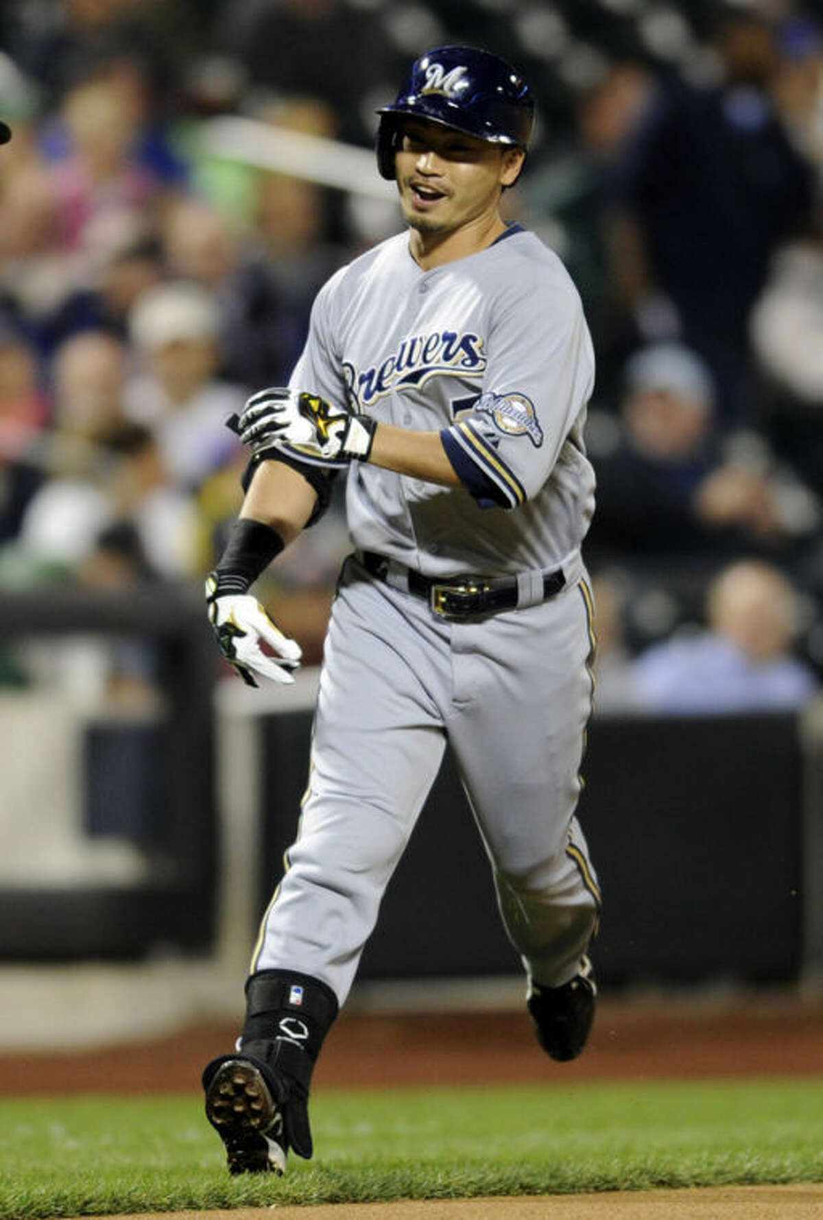 Milwaukee Brewers' Norichika Aoki reacts as he rounds the bases with a home run during the first inning of a baseball game against the New York Mets Friday, Sept. 27, 2013, in New York. (AP Photo/Bill Kostroun)