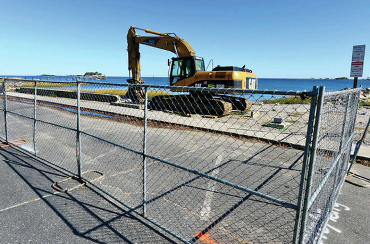Hour photo / Erik Trautmann Signs of construction beginning at the Calf Pasture Beach seawall.