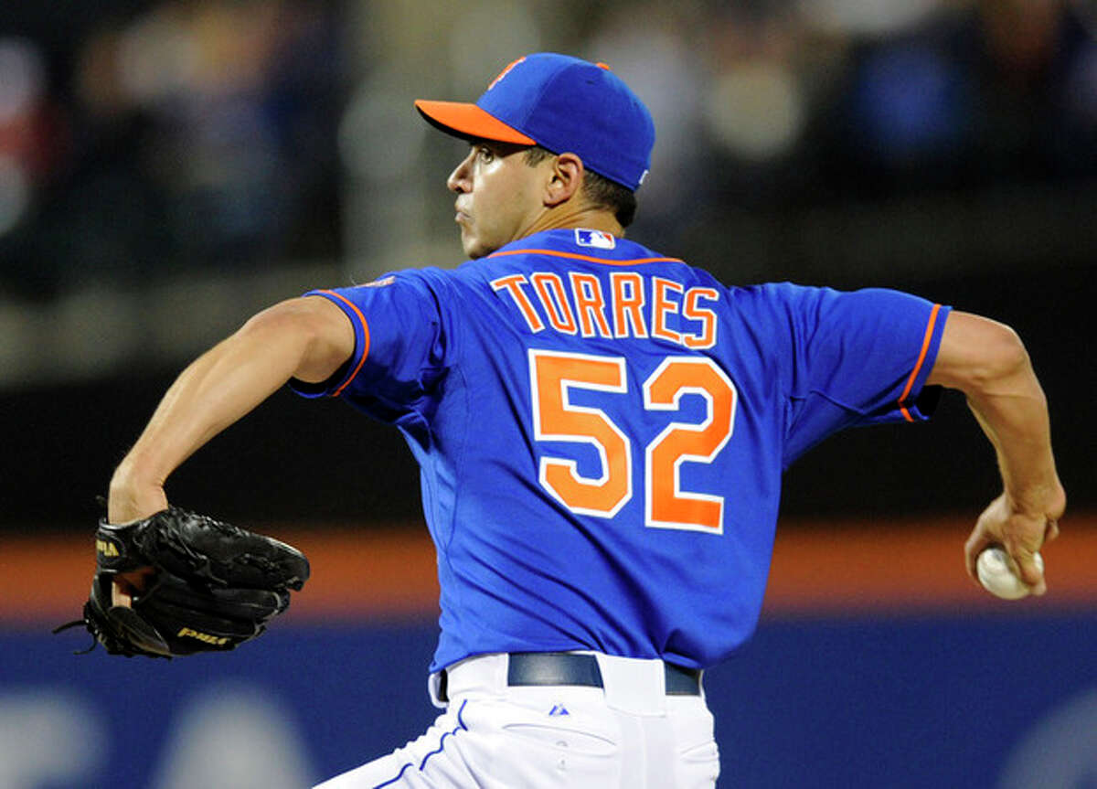 New York Mets pitcher Carlos Torres delivers the ball to the Milwaukee Brewers during the first inning of a baseball game Friday, Sept. 27, 2013, in New York. (AP Photo/Bill Kostroun)