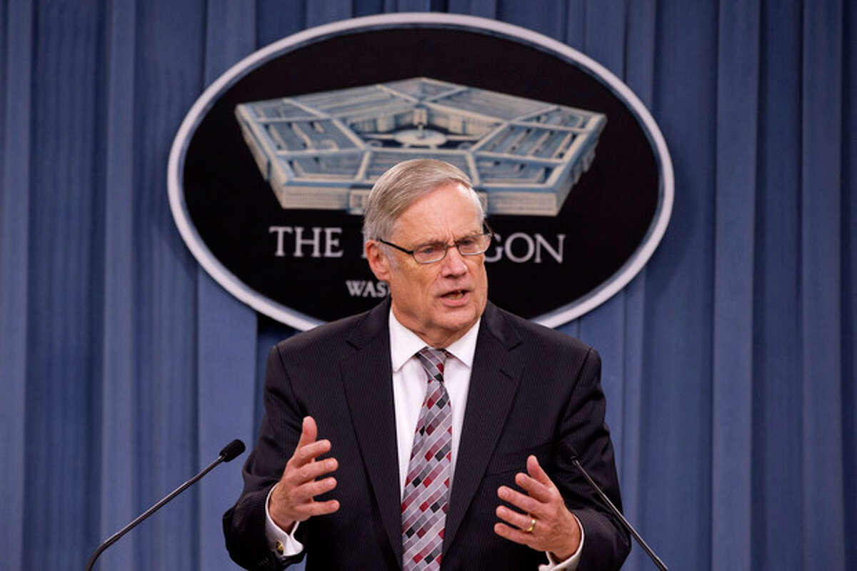 AP Photo/Jacquelyn Martin Defense Undersecretary Robert Hale gestures while speaking during a news conference at the Pentagon, Friday, Sept. 27, about preparations being made in the event of a government shutdown involving the Defense Department.
