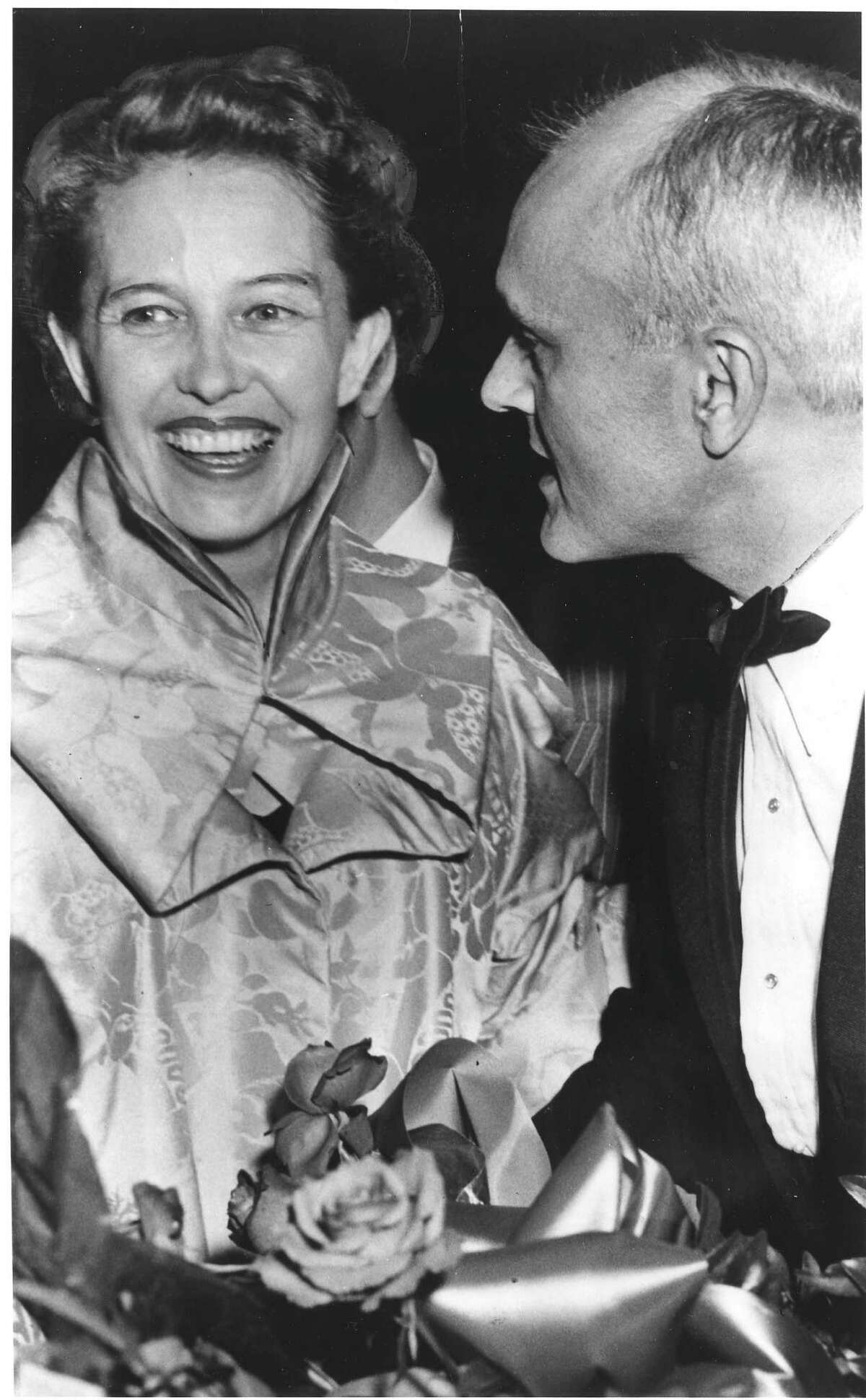 Dominique de Menil and architect Philip Johnson share stories at a party in 1949.