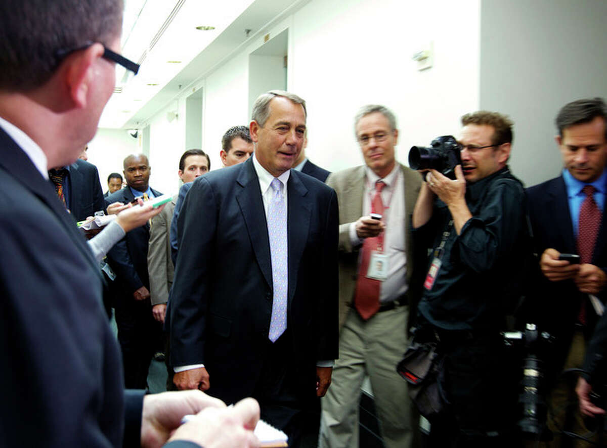 House Speaker John Boehner of Ohio, walks out of a Republican caucus at the U.S. Capitol in Washington, Saturday, Sept. 28, 2013. Lawmakers from both parties urged one another in a rare weekend session to give ground in their fight over preventing a federal shutdown, with the midnight Monday deadline fast approaching. (AP Photo/Molly Riley)