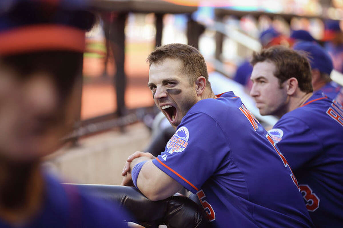 New York Mets third baseman David Wright (5) yawns in the dugout in the third inning of a baseball game against the Milwaukee Brewers at Citi Field, Saturday, Sept. 28, 2013, in New York. (AP Photo/John Minchillo)
