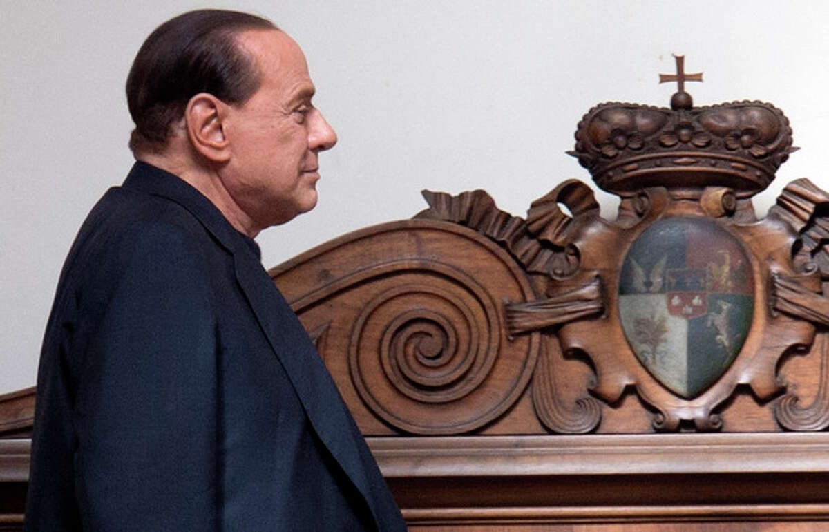 FILE - In this Thursday, Sept. 19, 2013 file photo former Italian Premier Silvio Berlusconi arrives in his private residence, in Rome. Government ministers in former Premier Silvio Berlusconi's political party have announced Saturday, Sept. 28, 2013 their intention to resign their posts, a move that raises tension in the uneasy coalition government and increases the possibility of early elections. Vice Premier Angelino Alfano's spokeswoman said Saturday the five ministers from Berlusconi's center-right People of Freedom Party have decided to submit their resignations. (AP Photo/Andrew Medichini, Files)