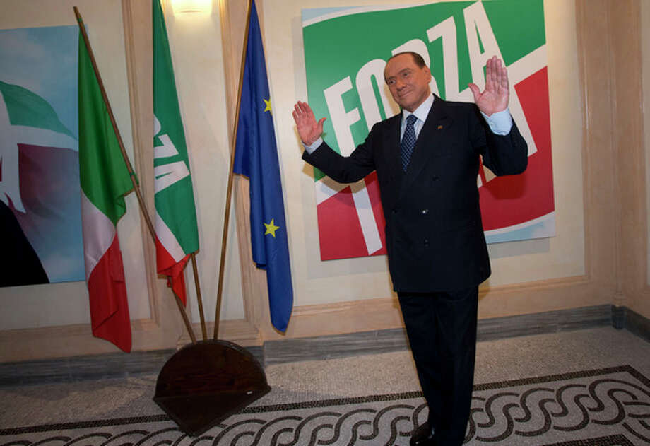 "FILE - In this Thursday, Sept. 19, 2013 file photo, former Italian Premier Silvio Berlusconi pauses for photographers on the occasion of the inauguration the new headquarters of his ""Forza Italia"" (Go Italy) party, in Rome. Government ministers in former Premier Silvio Berlusconi's political party have announced Saturday, Sept. 28, 2013 their intention to resign their posts, a move that raises tension in the uneasy coalition government and increases the possibility of early elections. Vice Premier Angelino Alfano's spokeswoman said Saturday the five ministers from Berlusconi's center-right People of Freedom Party have decided to submit their resignations. (AP Photo/Andrew Medichini, Files) / AP"