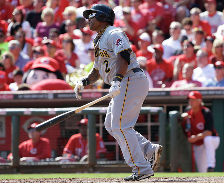 Pittsburgh Pirates' Marlon Byrd watches his two-run home run off Cincinnati Reds starting pitcher Bronson Arroyo in the fifth inning of a baseball game, Saturday, Sept. 28, 2013, in Cincinnati. (AP Photo/Al Behrman) / AP
