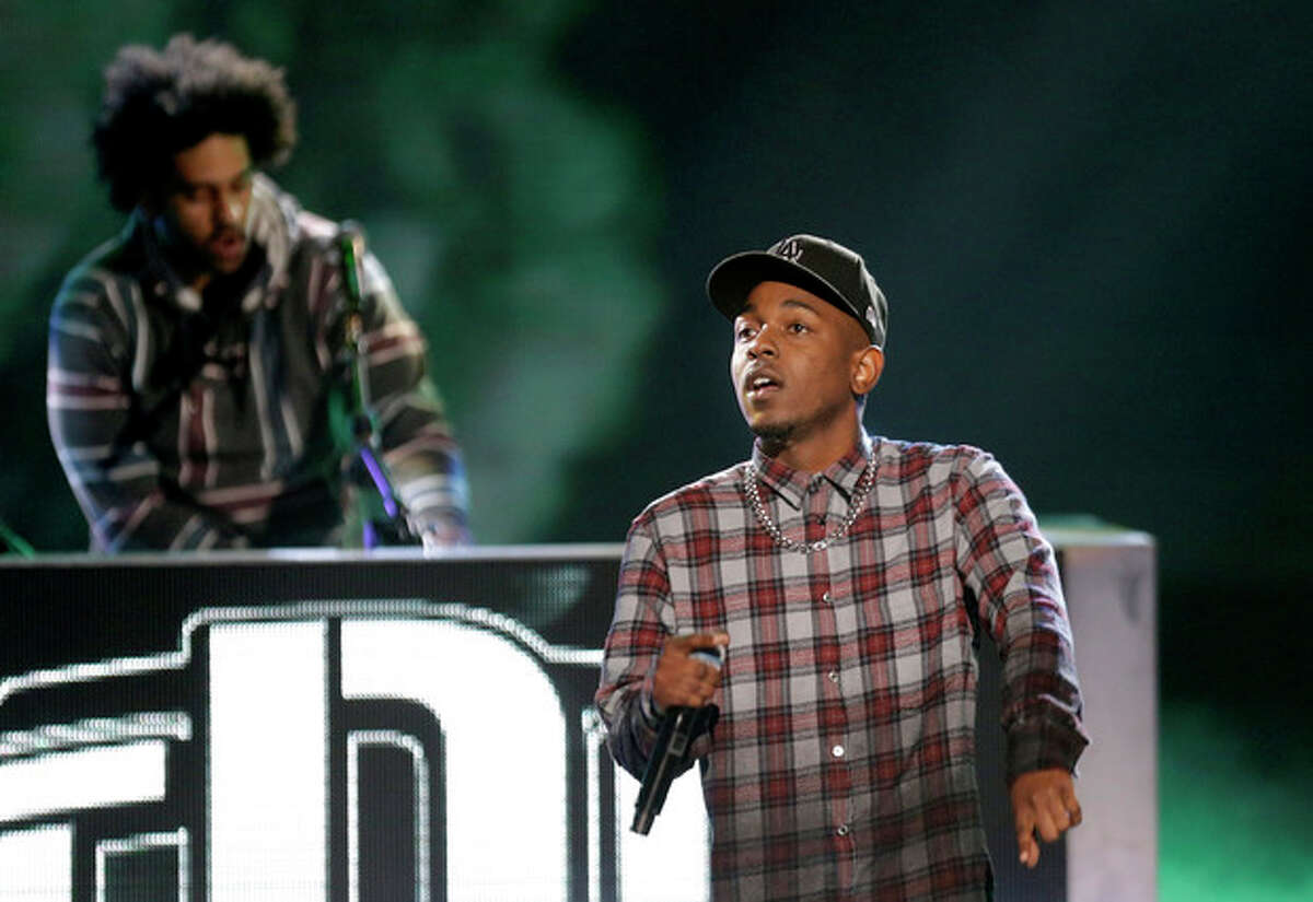 Rapper Kendrick Lamar, right, performs at the BET Hip Hop Awards, Saturday, Sept. 28, 2013, in Atlanta. (AP Photo/David Goldman)