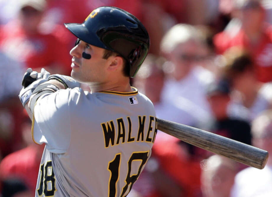 Pittsburgh Pirates' Neil Walker hits a solo home run off Cincinnati Reds starting pitcher Bronson Arroyo in the fifth inning of a baseball game, Saturday, Sept. 28, 2013, in Cincinnati. It was the second home run of the game for Walker. (AP Photo/Al Behrman) / AP
