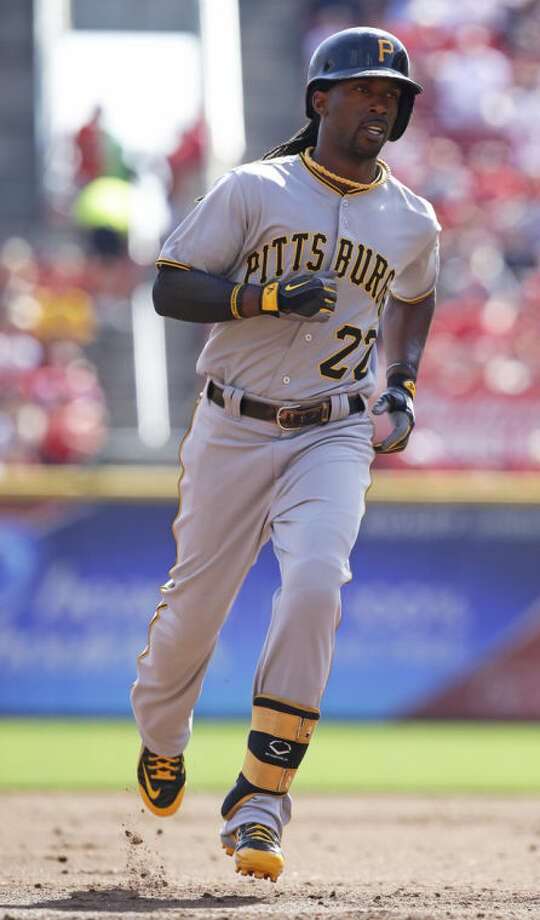 Pittsburgh Pirates' Andrew McCutchen rounds the bases after hitting a solo home run off Cincinnati Reds starting pitcher Bronson Arroyo in the third inning of a baseball game, Saturday, Sept. 28, 2013, in Cincinnati. (AP Photo/Al Behrman)