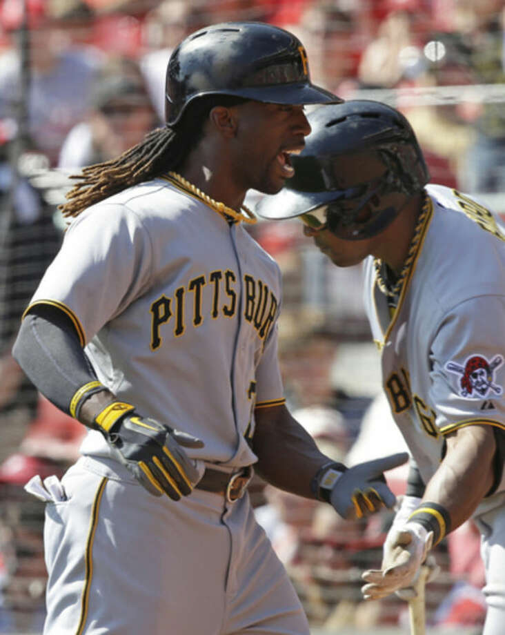 Pittsburgh Pirates' Andrew McCutchen, left, is congratulated by Marlon Byrd after McCutchen hit a solo home run off Cincinnati Reds starting pitcher Bronson Arroyo in the third inning of a baseball game, Saturday, Sept. 28, 2013, in Cincinnati. (AP Photo/Al Behrman)