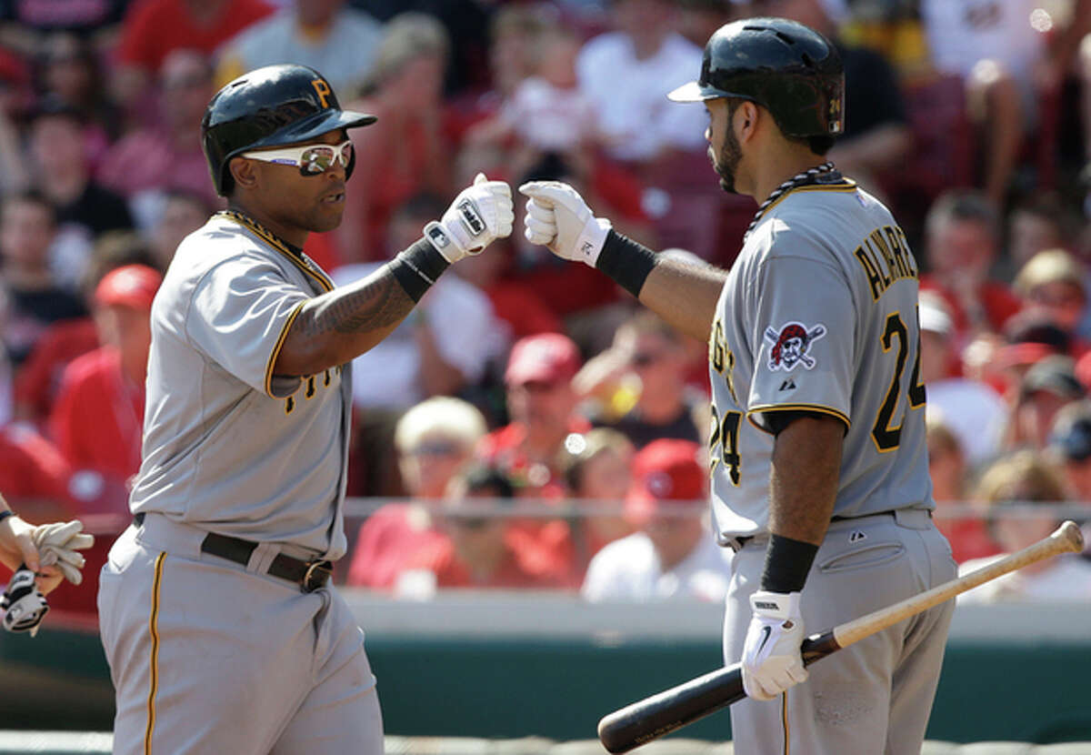 Pittsburgh Pirates' Marlon Byrd is congratulated by Pedro Alvarez (24) after Byrd hit a two-run home run off Cincinnati Reds starting pitcher Bronson Arroyo in the fifth inning of a baseball game, Saturday, Sept. 28, 2013, in Cincinnati. (AP Photo/Al Behrman)