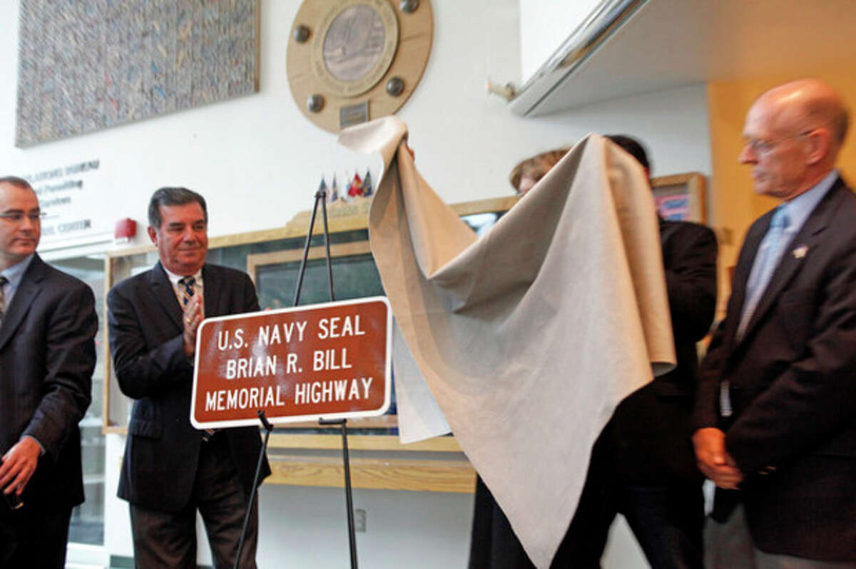 Hour Photo / Danielle Calloway A new street sign is revealed during a ceremony on Friday officially renaming sections of Washington Blvd. after Chief Petty Officer Brian Bill, a Stamford native who was killed along with 30 other SEALs in Afghanistan.