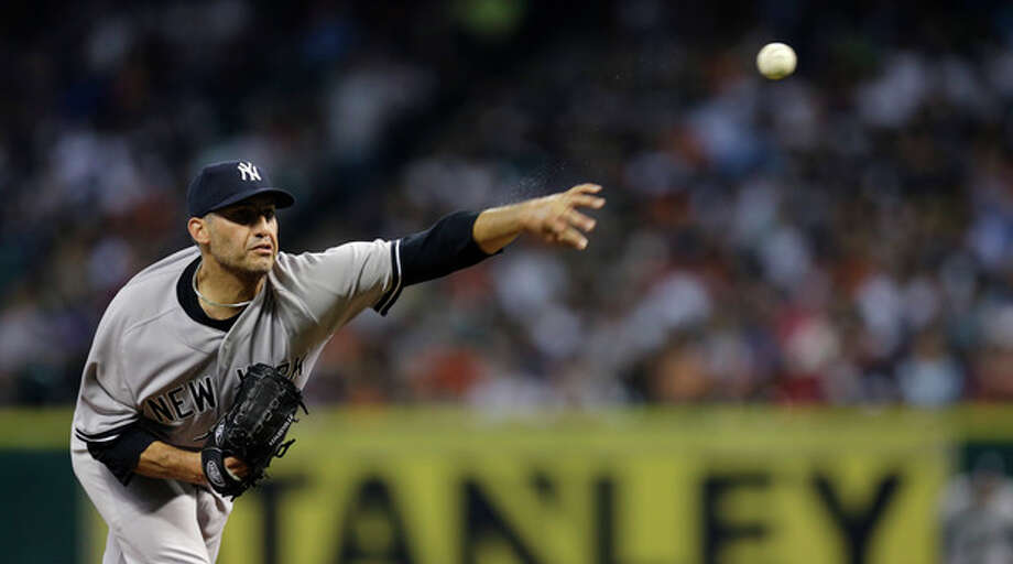 New York Yankees starting pitcher Andy Pettitte throws during the second inning of a baseball game against the Houston Astros Saturday, Sept. 28, 2013, in Houston. (AP Photo/David J. Phillip) / AP
