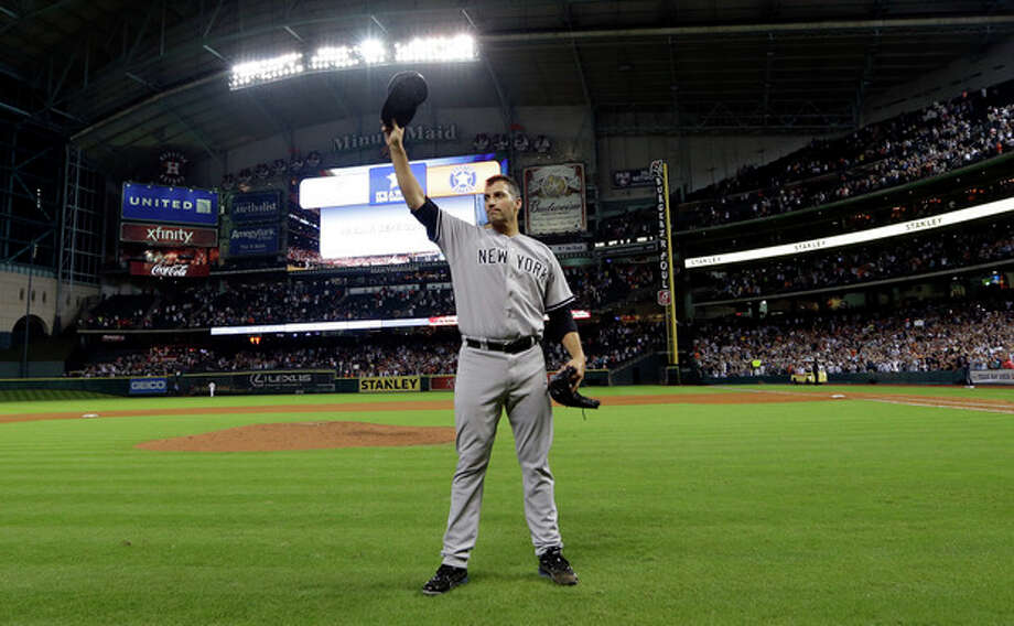 New York Yankees starting pitcher Andy Pettitte tips his hat to the crowd after pitching a complete baseball game against the Houston Astros Saturday, Sept. 28, 2013, in Houston. The Yankees beat the Astros 2-1. Pettitte is retiring at the end of the season.(AP Photo/David J. Phillip) / AP