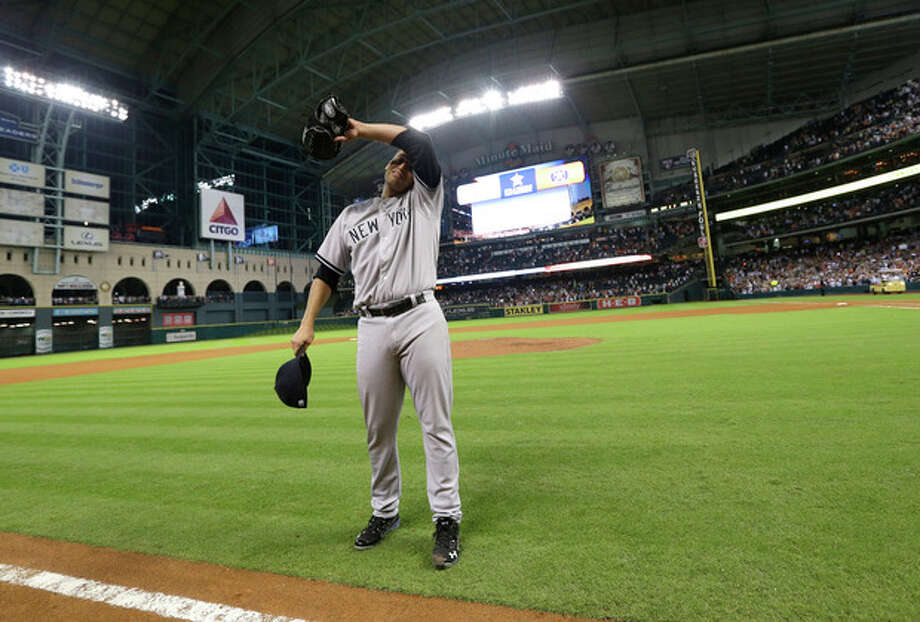 New York Yankees starting pitcher Andy Pettitte wipes his face after pitching a complete baseball game against the Houston Astros Saturday, Sept. 28, 2013, in Houston. The Yankees beat the Astros 2-1. Pettitte is retiring at the end of the season.(AP Photo/David J. Phillip) / AP