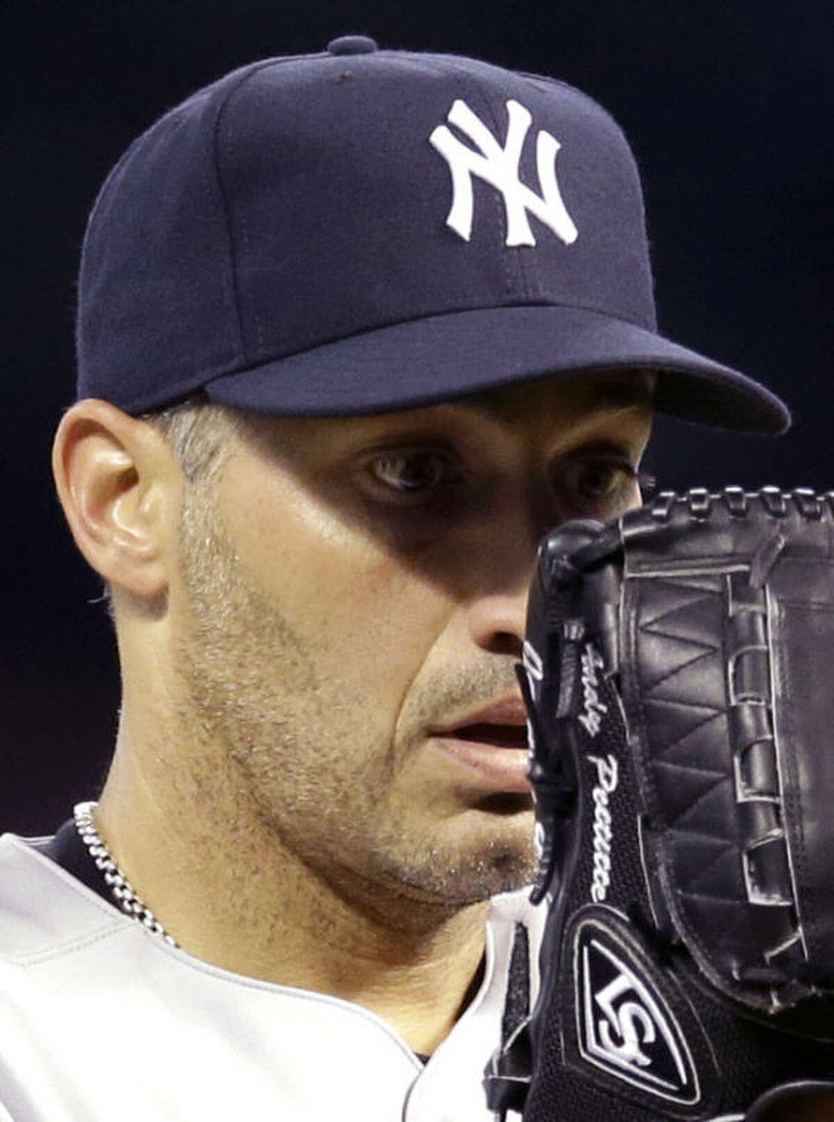 New York Yankees starting pitcher Andy Pettitte prepares to throw a pitch against the Houston Astros during the third inning of a baseball game Saturday, Sept. 28, 2013, in Houston. (AP Photo/David J. Phillip)