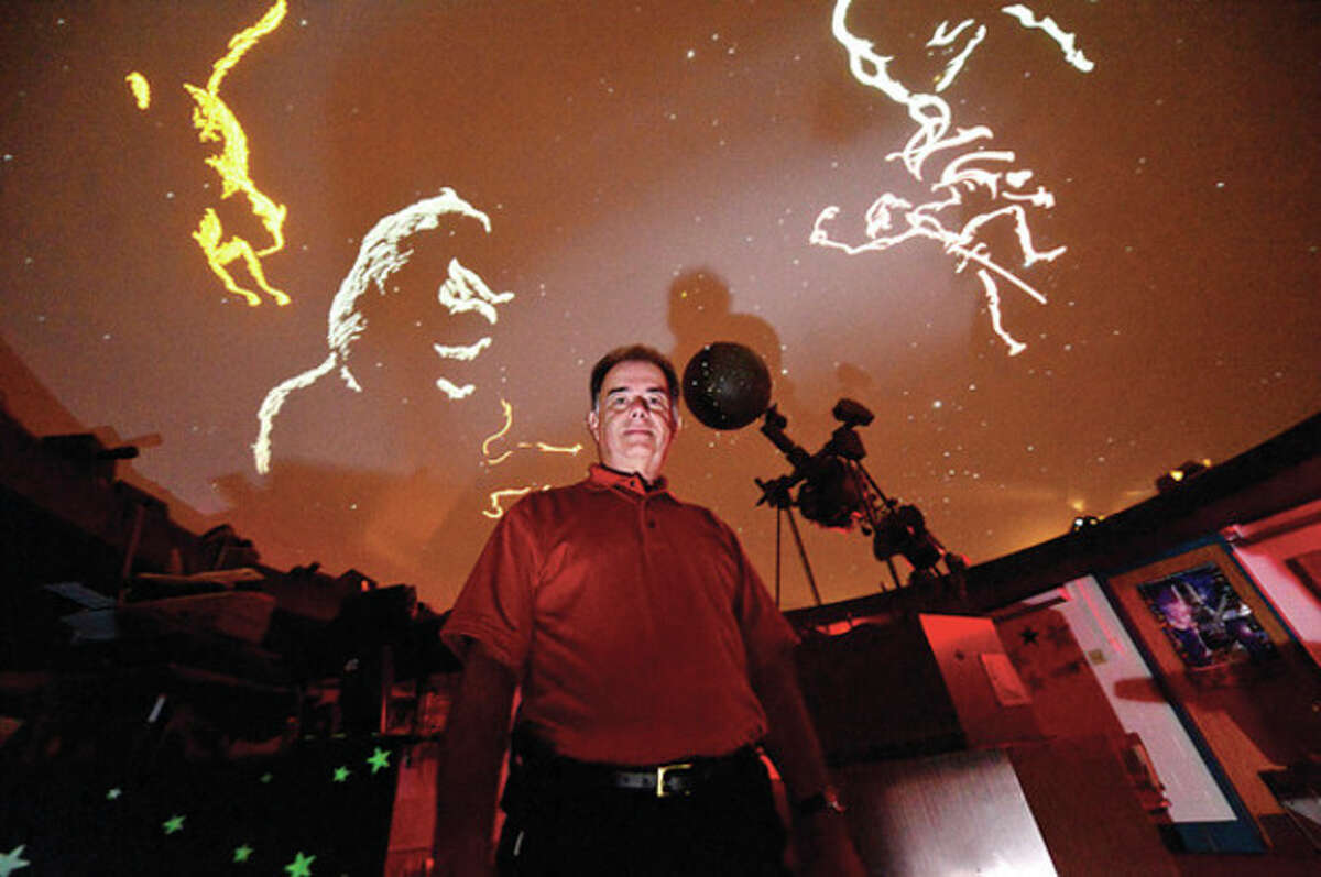 Hour photo / Erik Trautmann After nearly 20 years of running the Roton Middle School's planetarium, Ralph Mackenstein is retiring next month.
