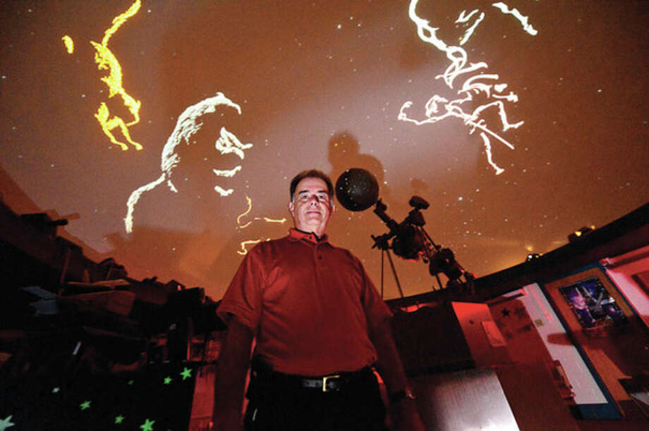 Hour photo / Erik TrautmannAfter nearly 20 years of running the Roton Middle School's planetarium, Ralph Mackenstein is retiring next month. / (C)2013, The Hour Newspapers, all rights reserved