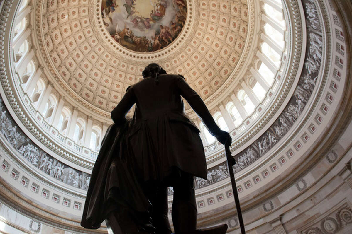 A statue of George Washington stands in the Rotunda of the U.S. Capitol Sunday morning, Sept. 29, 2013 as a government shutdown looms, in Washington. The political and economic stakes mounting with each tick of the clock, the White House and congressional Democrats say a House-approved delay in President Barack Obama's health care law does nothing but push Washington to the brink of the first government shutdown in 17 years. (AP Photo/Cliff Owen)