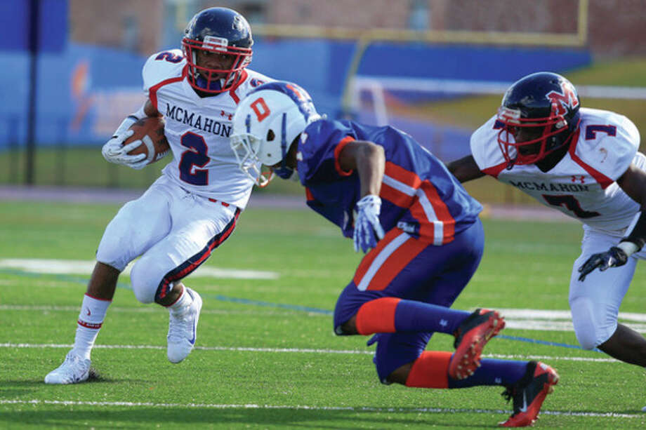 Hour Photo / Chris Palermo Malik Whittaker runs through defenders during McMahon's 21-7 win over the Hatters at Danbury High School Saturday afternoon. / © 2013 Hour Newspapers All Rights Reserved