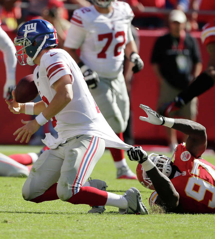 New York Giants quarterback Eli Manning (10) is tackled by Kansas City Chiefs defensive end Allen Bailey (97) during the second half of an NFL football game at Arrowhead Stadium in Kansas City, Mo., Sunday, Sept. 29, 2013. The Chiefs defeated the Giants 31-7. (AP Photo/Charlie Riedel) / AP