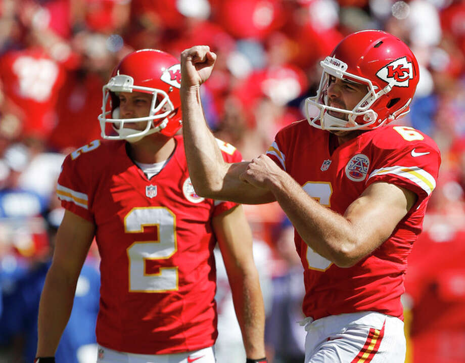 Kansas City Chiefs kicker Ryan Succop (6) celebrates a field goal with holder Dustin Colquitt (2) during the first half of an NFL football game against the New York Giants at Arrowhead Stadium in Kansas City, Mo., Sunday, Sept. 29, 2013. (AP Photo/Ed Zurga) / FR34145 AP