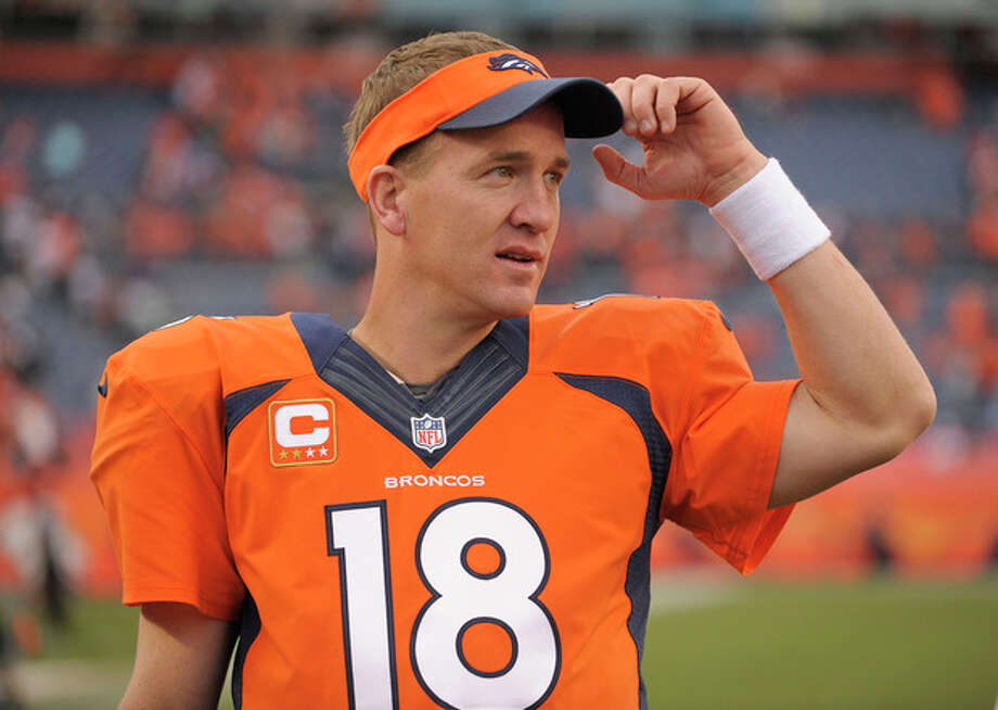 Denver Broncos quarterback Peyton Manning (18) watches play from the sidelines late in the fourth quarter against the Philadelphia Eagles in an NFL football game, Sunday, Sept. 29, 2013, in Denver. Denver won 52-20. (AP Photo/Jack Dempsey) / FR42408 AP