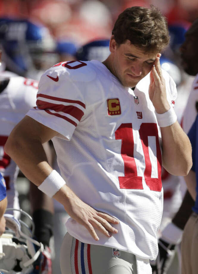New York Giants quarterback Eli Manning (10) stands on the sideline during the second half of an NFL football game against the Kansas City Chiefs at Arrowhead Stadium in Kansas City, Mo., Sunday, Sept. 29, 2013. (AP Photo/Charlie Riedel)