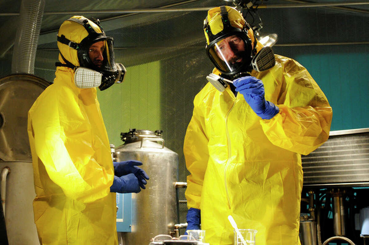 This image released by AMC shows Jesse Pinkman, played by Aaron Paul, left, and Walter White, played by Bryan Cranston, cooking meth in a home being fumigated in the fifth season of