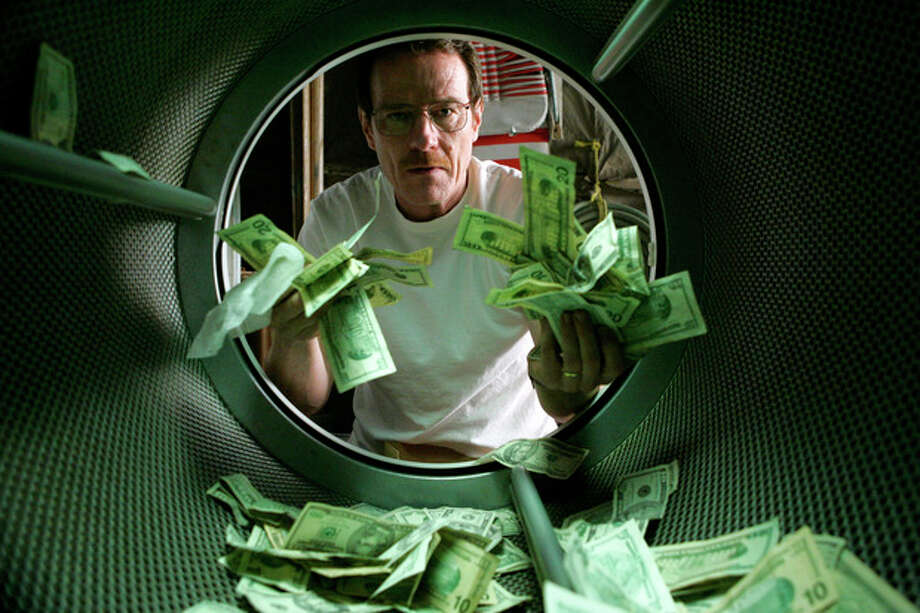 "This image released by AMC shows Bryan Cranston as Walter White laundering money in the pilot episode of ""Breaking Bad."" The series finale of the popular drama series airs on Sunday, Sept. 29. (AP Photo/AMC, Doug Hyun) / AMC"