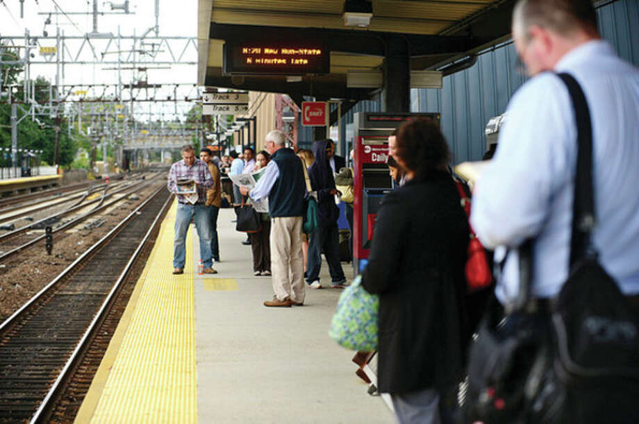 Metro North passengers get to their destinations Thursday morning at the South Norwalk train station. / (C)2013, The Hour Newspapers, all rights reserved