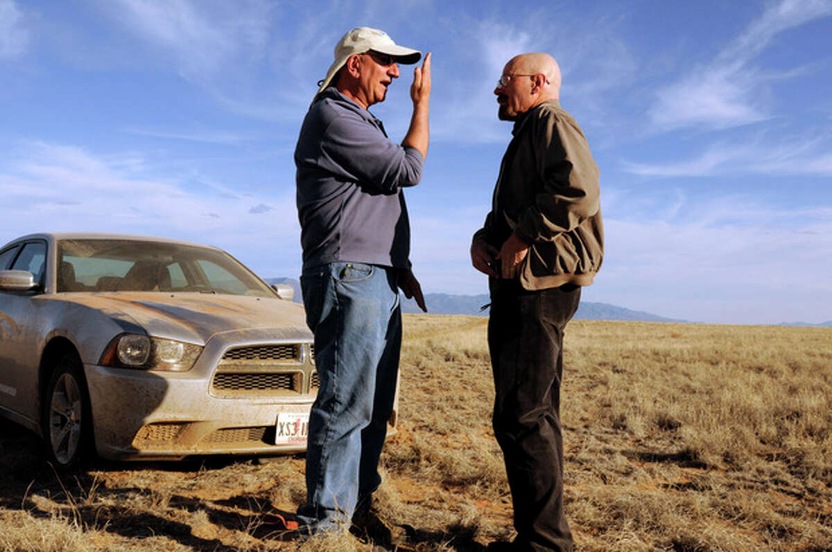 This 2012 photo released by AMC shows cinematographer Michael Slovis, left, and Bryan Cranston on the set of