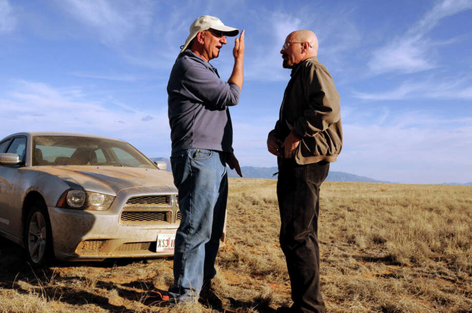 "This 2012 photo released by AMC shows cinematographer Michael Slovis, left, and Bryan Cranston on the set of ""Breaking Bad."" The series finale will air on Sunday, Sept. 29. (AP Photo/AMC, Ursula Coyote) / AMC"