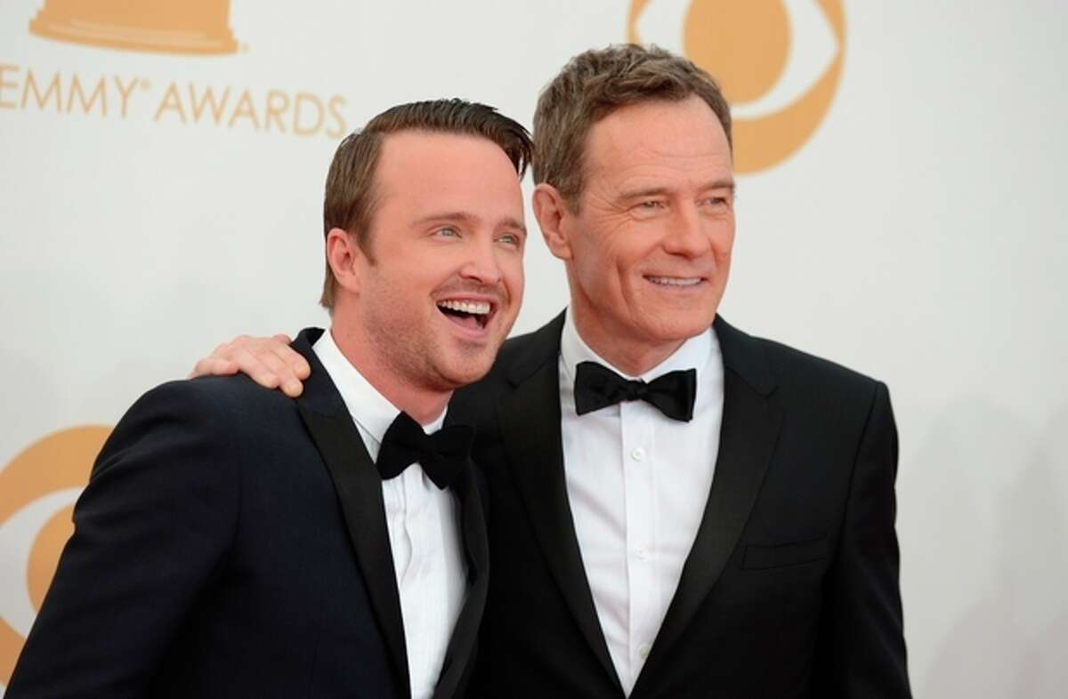 FILE - In a Sunday Sept. 22, 2013 file photo, Aaron Paul, left, and Bryan Cranston arrive at the 65th Primetime Emmy Awards at Nokia Theatre, in Los Angeles. On Saturday, Sept. 28, 2013,