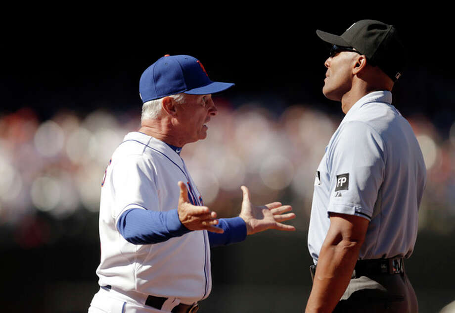 New York Mets manager Terry Collins, left, argues against first base umpire CB Bucknor 's fourth inning call in a baseball game against the Milwaukee Brewers, Sunday, Sept. 29, 2013, in New York. Bucknor ruled Brewers Sean Halton safe at first on a fielder's choice but both Collins and Mets starting pitcher Jonathon Niese thought Halton was out on the play. (AP Photo/Kathy Willens) / AP