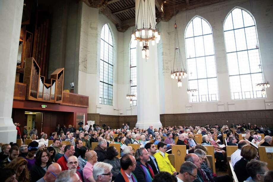 """Hundreds fill St. Mark's Cathedral for the prayer, vigil and procession in solidarity and hope following the shooting at a club in Orlando this past weekend, on Wednesday, June 15, 2016. The governing vestry of the Episcopal cathedral has just adopted a statement saying: """"We will name racism, anti-Semitism and xenophobia as sins. We believe all people are made in God's image, and we affirm diversity as a gift, blessing and opportunity to our nation.""""  Photo: GRANT HINDSLEY, SEATTLEPI.COM / SEATTLEPI.COM"""