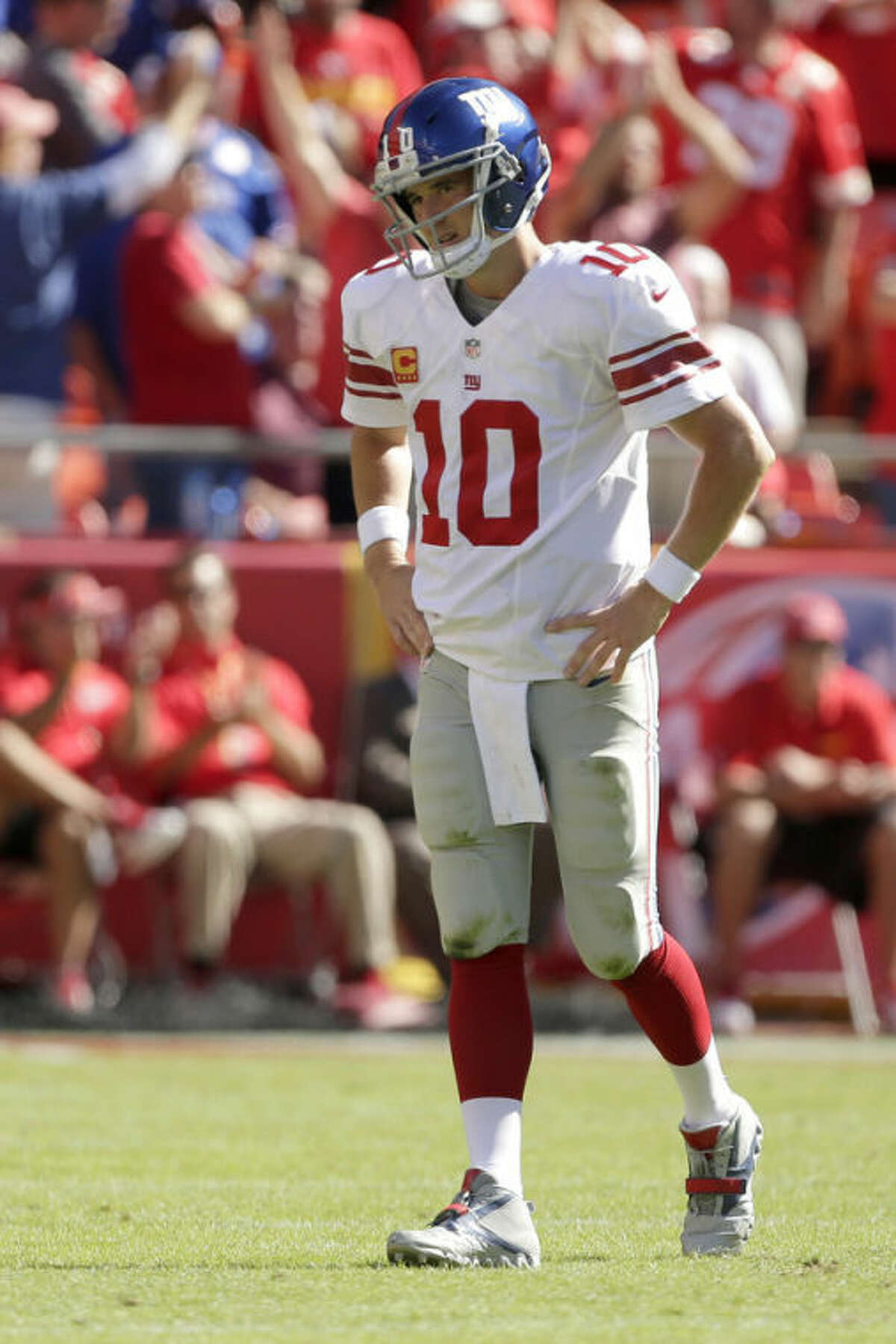New York Giants quarterback Eli Manning (10) walks off the field after a turnover during the second half of an NFL football game against the Kansas City Chiefs at Arrowhead Stadium in Kansas City, Mo., Sunday, Sept. 29, 2013. The Chiefs defeated the Giants 31-7. (AP Photo/Charlie Riedel)